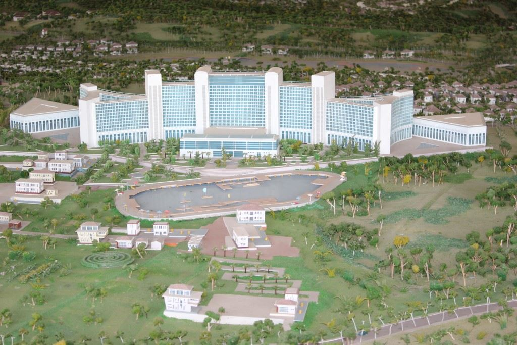 Scale model of large hotels and rows of villas.